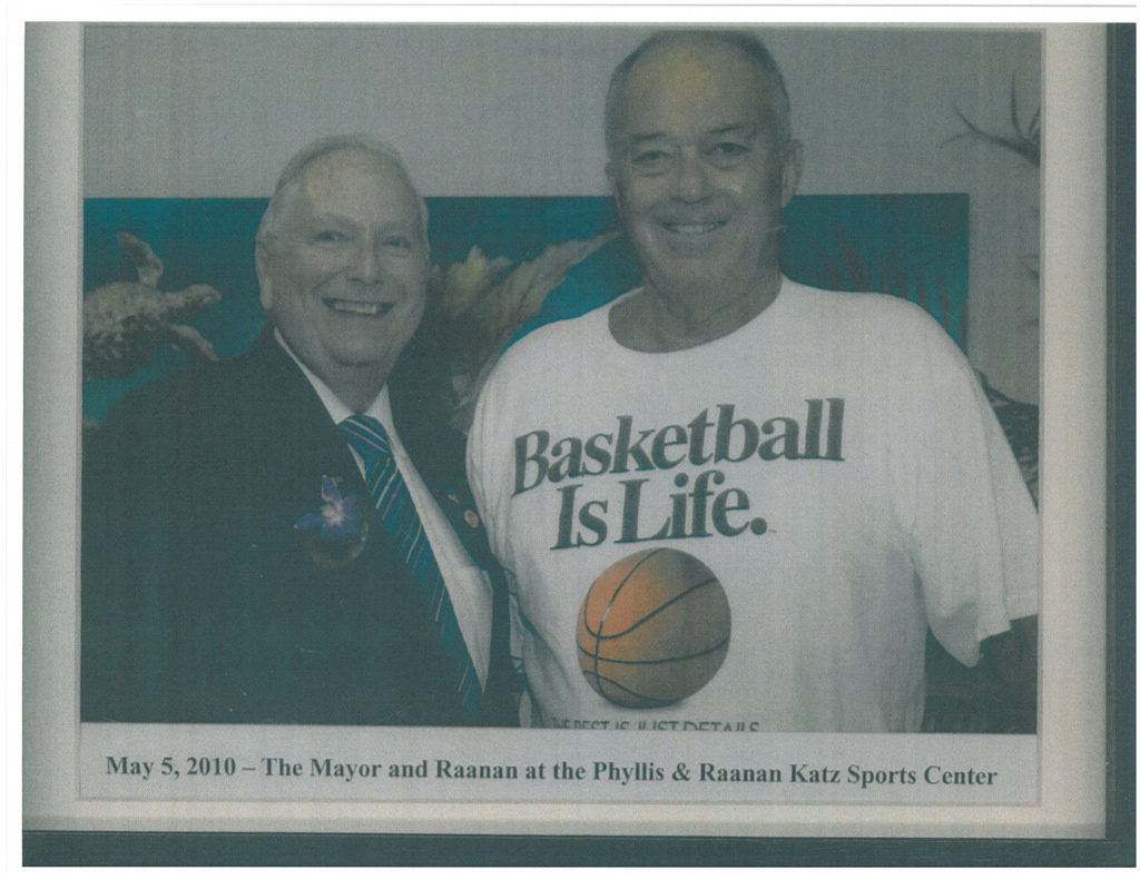 newspaper clipping of Raanan Katz posing with the mayor of sunny isles beach